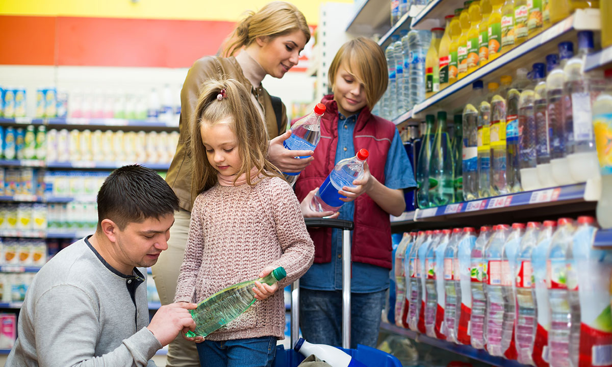 A family examining price labels in the supermarket