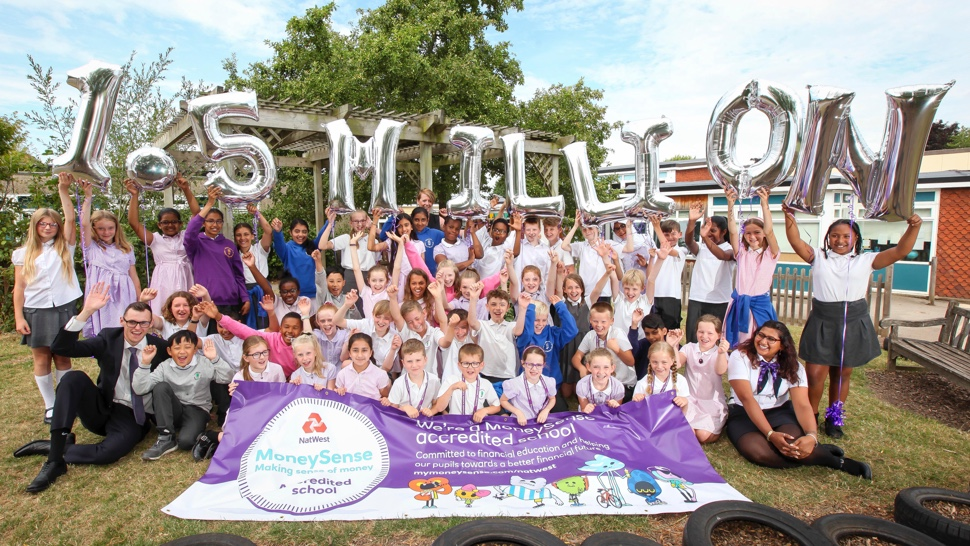School children with balloons celebrating that the MoneySense programme has reached 1.5 million students in England and Wales