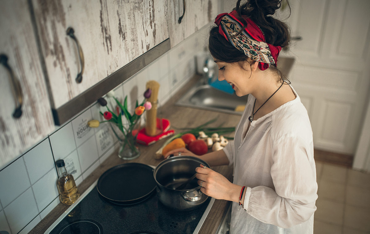 A girl prepares food in her kitchen